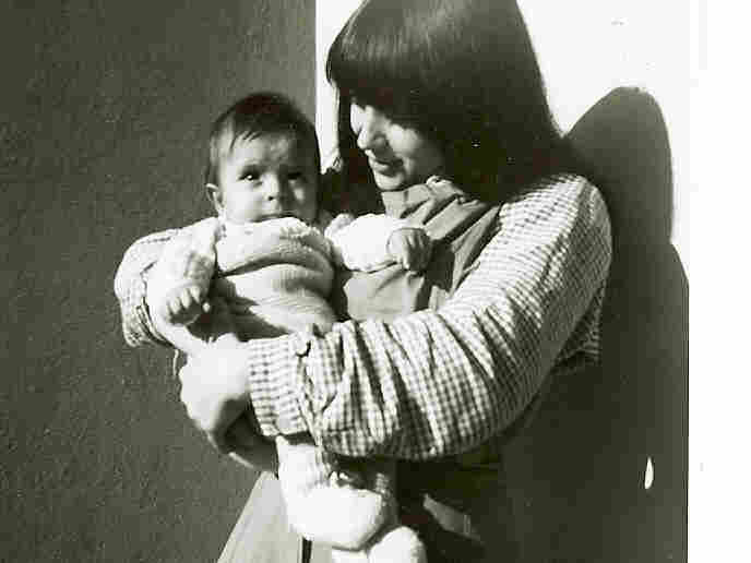 Ursula Biondi and son (both in brown prison clothes) in an undated photo.