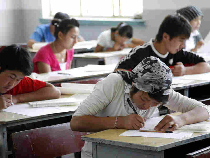 Students take China's national college entrance exam in June 20009