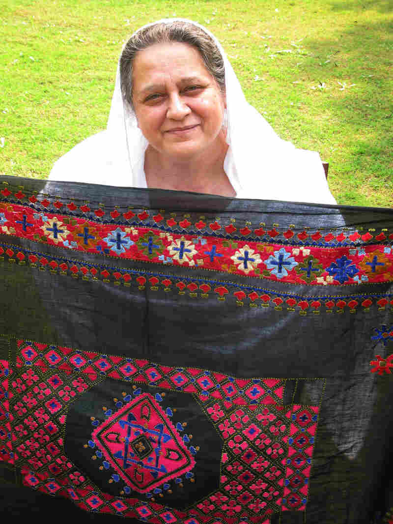 Princess Mussarat Ahmed Zeb displays a piece of Swati embroidery