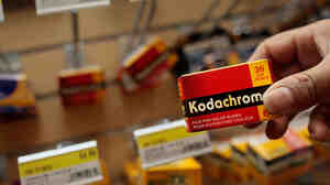A saleswoman holds a box of Kodachrome film June 22, 2009 in an electronics shop in lower Manhattan in New York City.