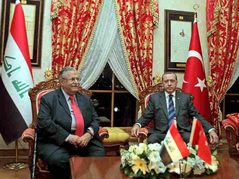 Turkey's Prime Minister Recep Tayyip Erdogan (right) meets with Iraqi President Jalal Talabani in Istanbul