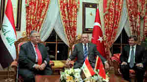 Turkey's Prime Minister Recep Tayyip Erdogan (right) meets with Iraqi President Jalal Talabani in Istanbul