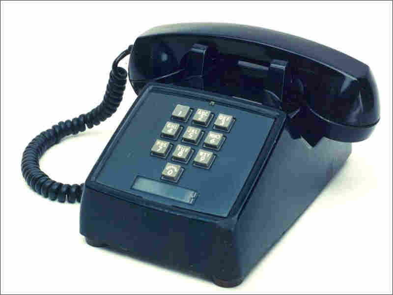 A landline, push-button phone, circa 1964.