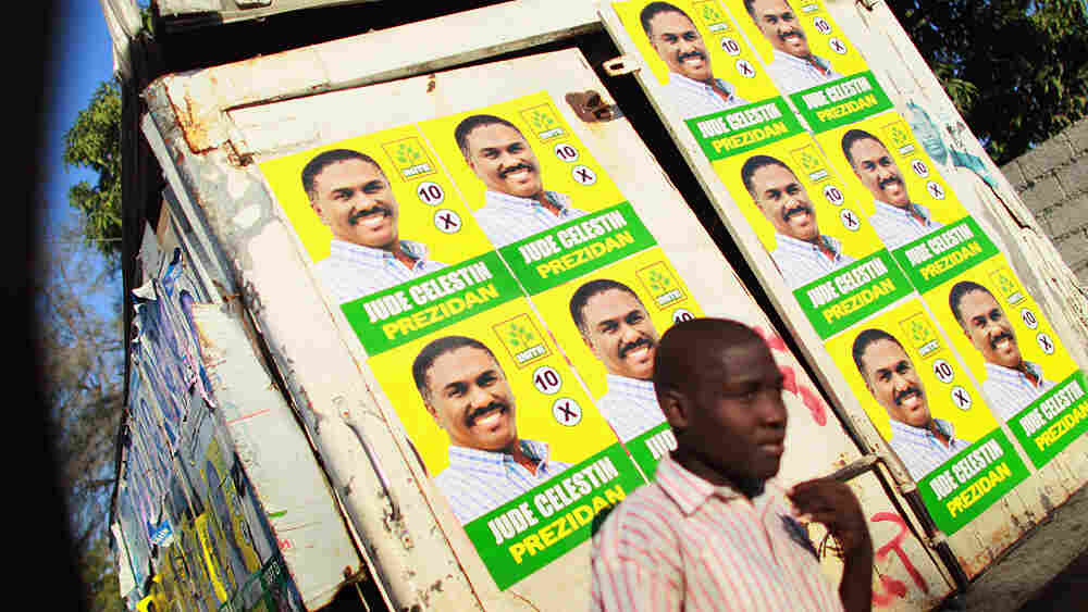 Campaign posters for presidential candidate Jude Celestin are seen on a wall in Port-au-Prince, Haiti.