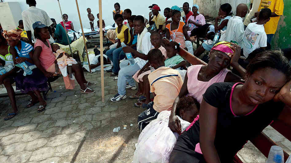 People suffering from dehydration wait to be treated at St. Nicholas Hospital in Saint-Marc, north of Port-au-Prince.