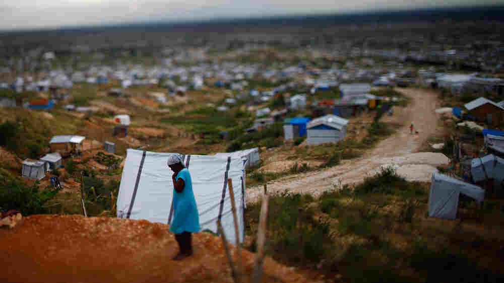 A woman walks through a tent city outside the Haitian capital, Port-au-Prince
