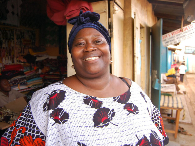 Pamela Omiyo, who sells dresses and suits in the Nairobi slum of Kibera, says M-PESA has  helped triple her business in recent years.