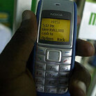 A man sends money through M-Pesa