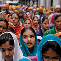 Immigrants like these Indians at a Sikh festival in Barcelona are bolstering Europe's stagnant population growth rate.