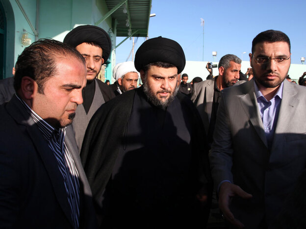 Anti-American cleric Muqtada al-Sadr, center, is surrounded by bodyguards in his hometown, the  Shiite city of Najaf, Iraq, Jan. 6. Hundreds of raucous supporters celebrated  the return of the firebrand Iraqi cleric Thursday after his emergence from four  years of exile in Iran.