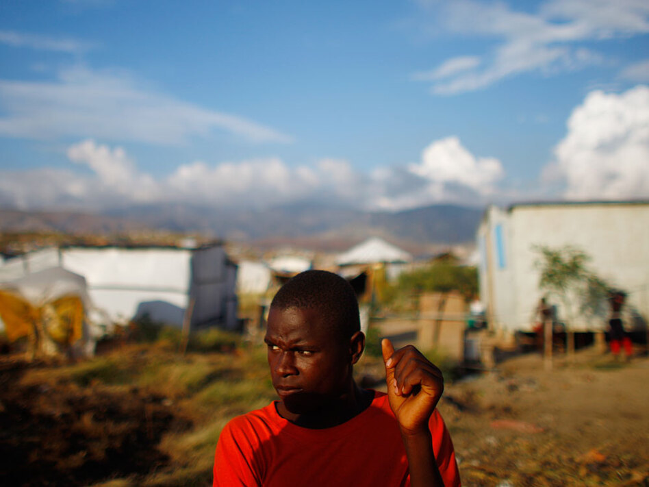 Pierre Jean Lefen, 18, is among the thousands of Haitians who have built their own homes in the scrubby hills north of Port-au-Prince in an area known as Cabaret. Residents pay Lefen roughly 25 cents to fill up their buckets from a well that is the only nearby source of water.
