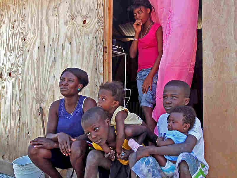 Wislyn Jean Charles (left) and her family were among the lucky ones to be assigned a transitional shelter at the Cite Soleil camp