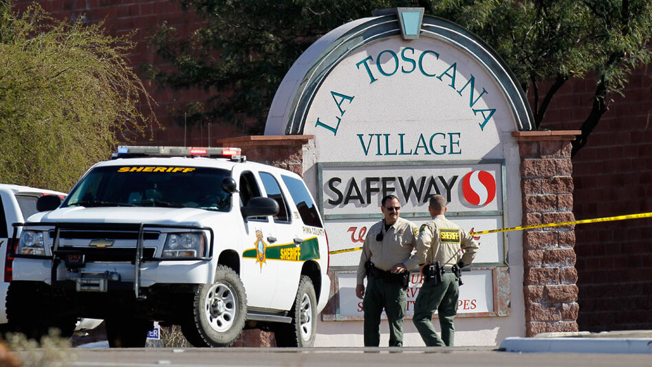 Law enforcement  officials were still trying to piece together a chronology of events and  a possible motive  for Saturday's shooting rampage at a Safeway in  Tucson, Ariz. (Kevin C. Cox/Getty Images)