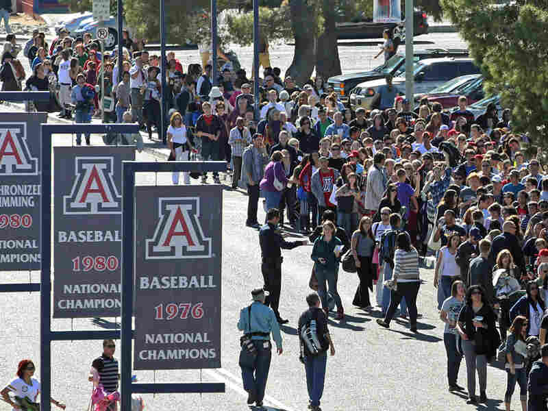 People line up to get in to a memorial service for the victims of Saturday's shootings. The service was held at the University of Arizona campus in Tucson on Wednesday.