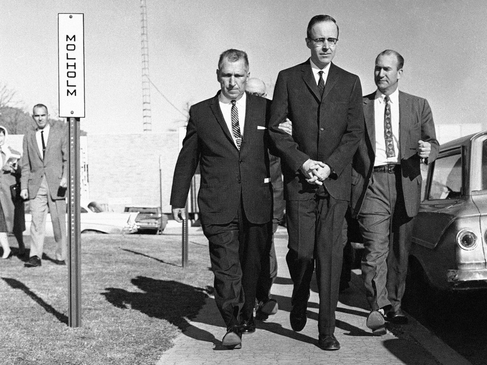 Joseph Corbett (center), who was convicted of killing millionaire Adolph Coors III, is led to the Jefferson County  courthouse in Golden, Colo., in 1961. (John F. Urwiller/AP)
