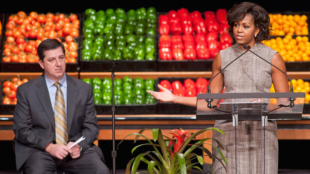First lady Michelle Obama and Bill Simon, head of Walmart's U.S. operations