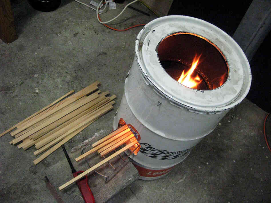 "This stove at Aprovecho's lab in Cottage Grove, Ore., has a basic ""rocket stove"" design built from a 55-gallon oil drum. Its insulated ""combustion chamber"" is precisely engineered to extract energy from wood."