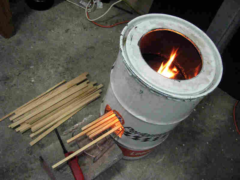 """This stove at Aprovecho's lab in Cottage Grove, Ore., has a basic """"rocket stove"""" design built from a 55-gallon oil drum. Its insulated """"combustion chamber"""" is precisely engineered to extract energy from wood."""