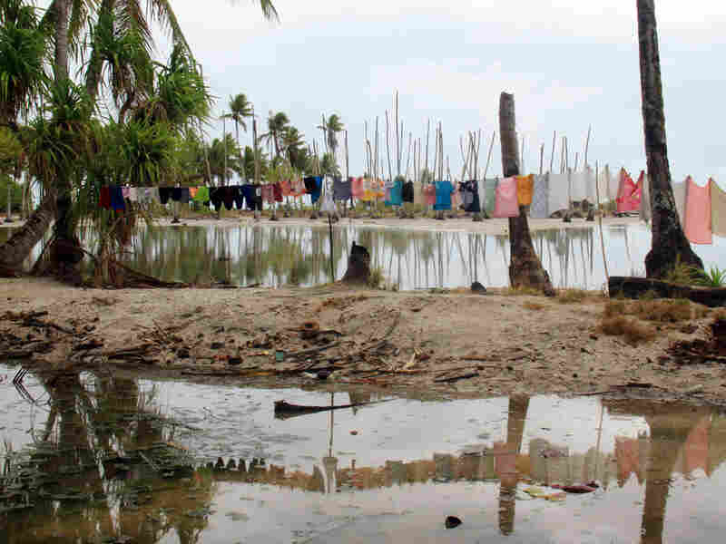 The village of Tebunginako, on one of Kiribati's remote outer islands, Abaiang. Residents were forced to relocate after the sea inundated the  village.