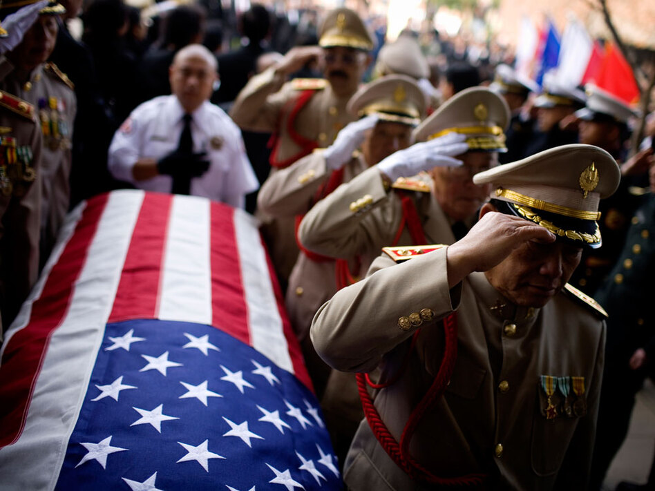 Military officials salute the casket of Gen. Vang Pao in Fresno, Calif. (Lianne Milton for NPR)