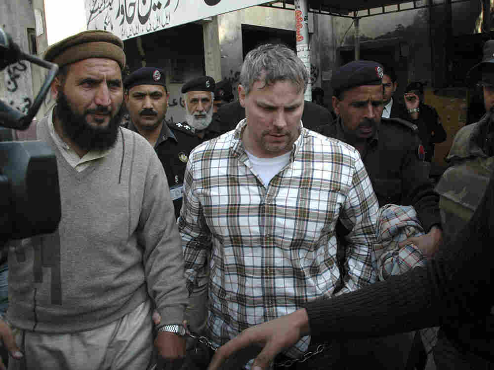 Raymond Davis, pictured here on Jan. 28 being escorted to a local court in Lahore, Pakistan, had been working as a CIA security contractor for the U.S. consulate in Lahore, according to former and current U.S. officials, who spoke on condition of anonymity because they weren't authorized to talk publicly about the incident.