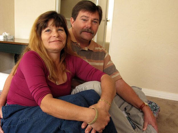 Philip Doud and his girlfriend, Cathy Espong, sit in their new one-bedroom apartment. They both lost their jobs and were found living on a San Diego sidewalk during a survey of the city's homeless population last fall. The Department of Veterans Affairs helped move the couple into permanent housing as part of a campaign to end homelessness. (NPR)