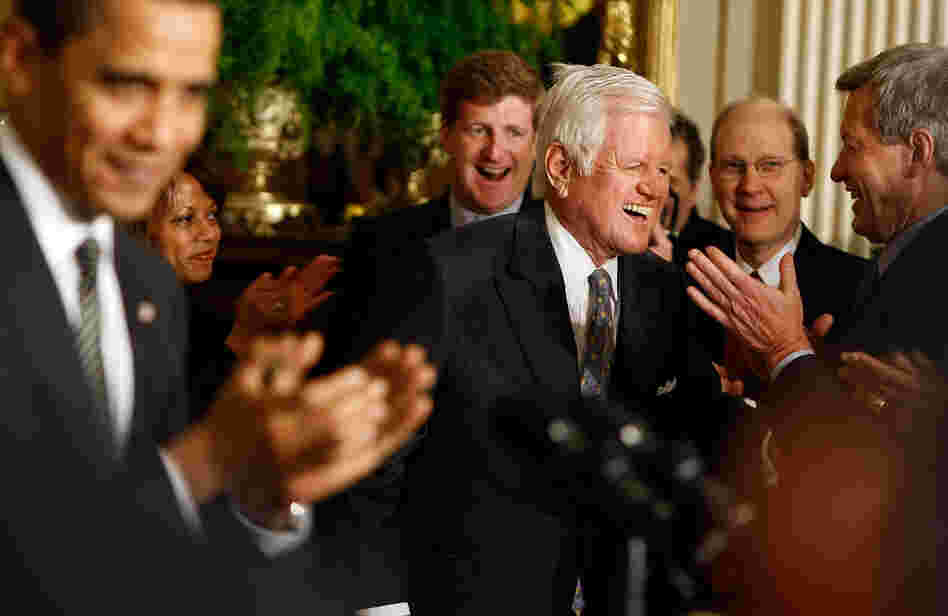 President Obama and others clap for Sen. Kennedy at the White House forum on health care reform.