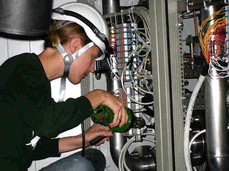 Graduate student Sarah Lockwitz works on machinery.