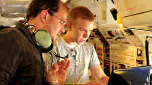 Daniel Tkacik (right) analyzes the composition of air samples sucked in from outside the plane.