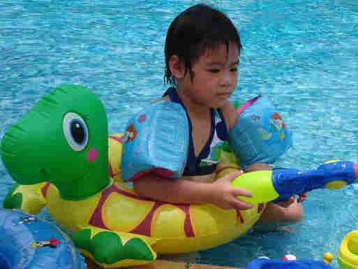 Harper Scruggs plays in a hotel pool in Beijing.