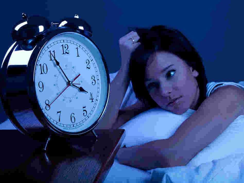 Woman looks at clock at 4 a.m.
