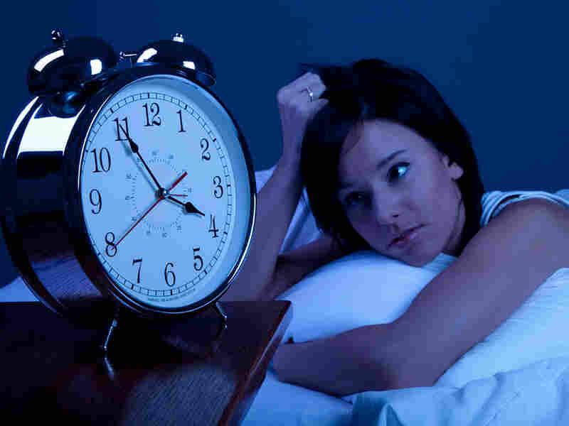 Woman looks at clock at 4 a.m.