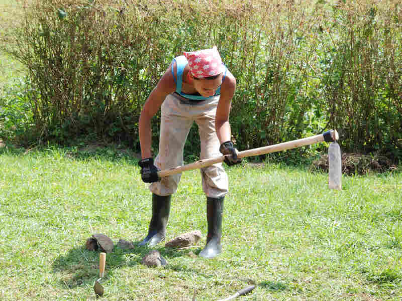 Gumboots protect Erin Marie Williams from driver ants as she excavates the burial site.