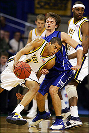 Creighton's Nate Turk defends against West Virginia's Tyrone Sally in March 2006.