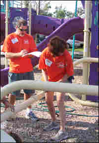 KaBOOM! volunteers assemble a jungle gym in Bay St. Louis, Miss.
