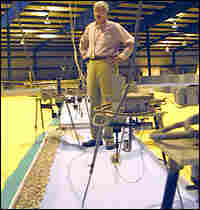 Engineer Bill Seabergh stands in the middle of a 1:50 scale model of the 17th Street canal.