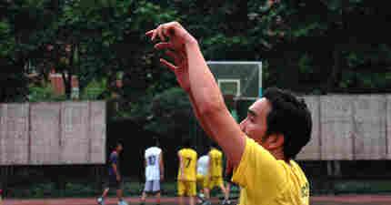 A man shooting a basketball.