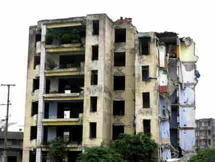 One of countless destroyed apartment buildings still standing in Dujiangyan, China, in 2009. Photo: