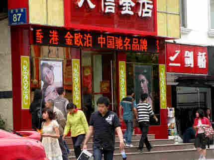 Dujiangyan in 2009 includes bustling streets. Photo: Melissa Block, NPR.