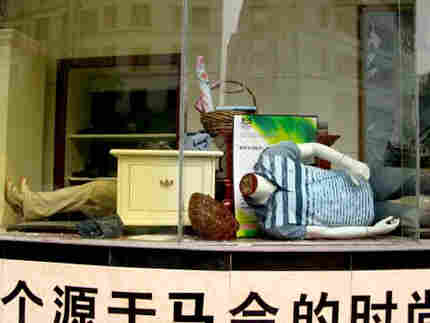 Mannequins in a storefront window after the 2008 earthquake. Photo: Melissa Block, NPR.