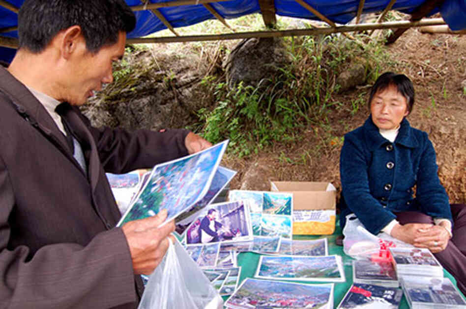 Local vendor Mu Zhenxian lost 16 relatives in the quake. She now sells photos and DVDs