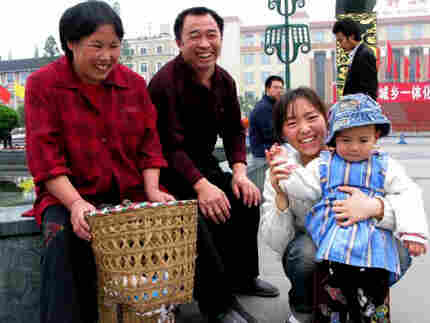 A smiling family in Chengdu, China. Photo: Melissa Block, NPR.