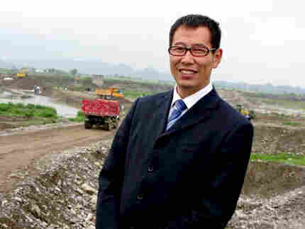 Bai Hua, of the Shandong Good Guy Construction Company, on the site of what will become the new city