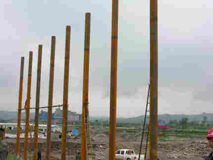 Gigantic pillars form the structure for a super-sized billboard that will promote the new city of Be
