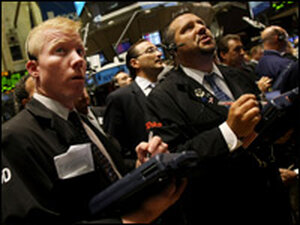 Wall Street traders watch as the stock market fal