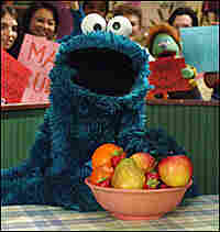 Cookie Monster with a bowl of fruit