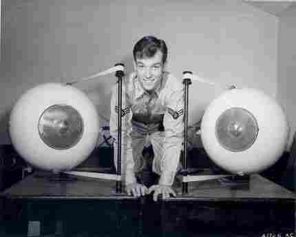 An instructor at the US Air Force School of Aviation Medicine poses with model eyeballs.