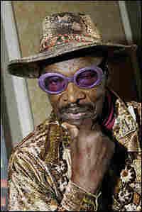 Rudy Ray Moore in purple glitter glasses