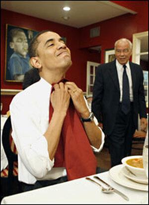 Barack Obama puts on a napkin preparing to eat