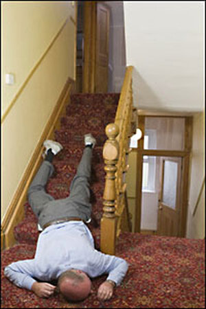 man lying on stairs, passed out from too much turkey